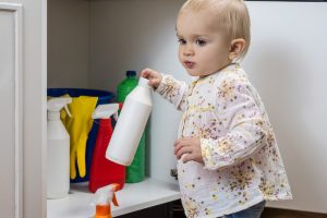 Toddler,Playing,With,Household,Cleaners,At,Home